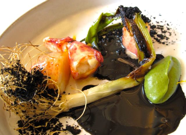 Lobster Poached with Leeks, Black Onion and Shellfish Bisque
