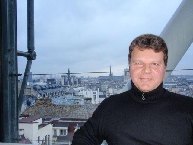 Os telhados e o entardecer de Paris a partir do George